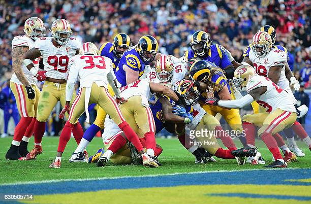 Todd Gurley of the Los Angeles Rams is stopped short of the goal line by the San Francisco 49ers defense during the fourth quarter of their game at...