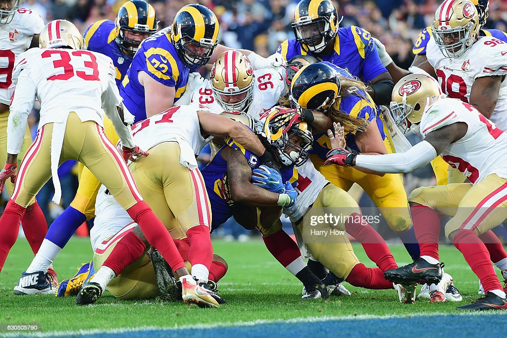 Todd Gurley #30 of the Los Angeles Rams is stopped short of the goal line by the San Francisco 49ers defense during the fourth quarter of their game at Los Angeles Memorial Coliseum on December 24, 2016 in Los Angeles, California.