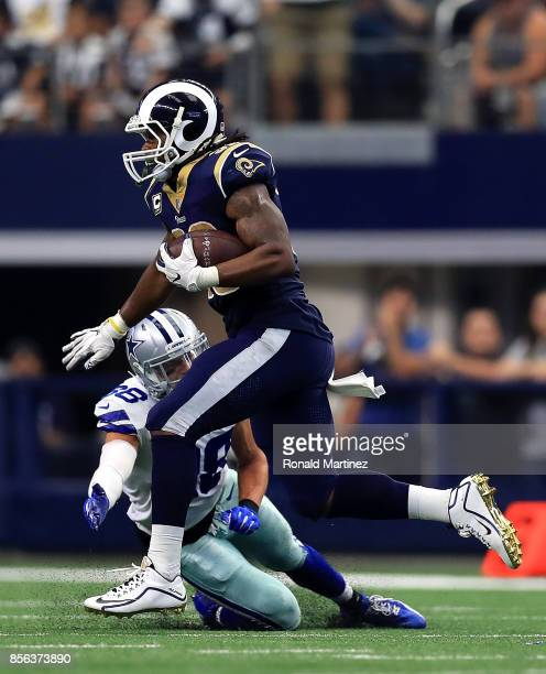 Todd Gurley of the Los Angeles Rams runs past Jeff Heath of the Dallas Cowboys for a touchdown in the third quarter at ATT Stadium on October 1 2017...
