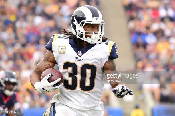 Todd Gurley of the Los Angeles Rams runs the ball down field during the game against the Houston Texans at the Los Angeles Memorial Coliseum on...