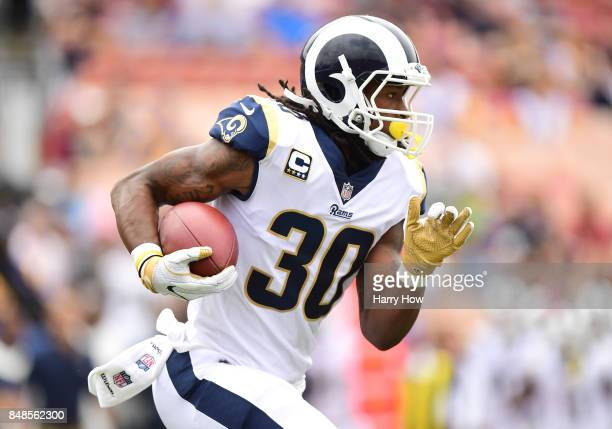 Todd Gurley of the Los Angeles Rams runs the ball during the first quarter against the Washington Redskins at Los Angeles Memorial Coliseum on...