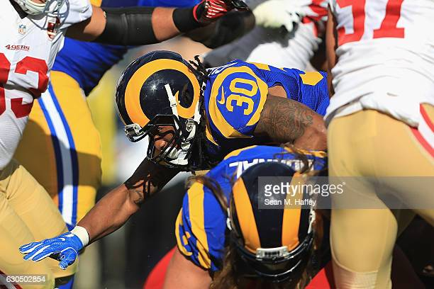 Todd Gurley of the Los Angeles Rams rushes for a 1yard touchdown during the first quarter against the San Francisco 49ers at Los Angeles Memorial...