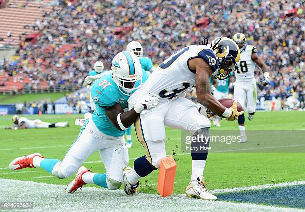 Todd Gurley of the Los Angeles Rams scores a touchdown in front of Michael Thomas of the Miami Dolphins in the first quarter of the game at Los...