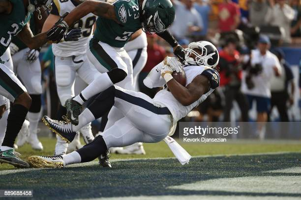 Todd Gurley of the Los Angeles Rams scores the first touchdown of the game during the first quarter of the game against the Philadelphia Eagles at...