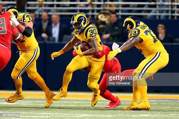 Todd Gurley of the St Louis Rams carries the ball in the first quarter against the Tampa Bay Buccaneers at the Edward Jones Dome on December 17 2015...