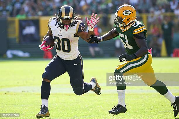 Todd Gurley of the St Louis Rams carries the football against Nate Palmer of the Green Bay Packers in the third quarter at Lambeau Field on October...