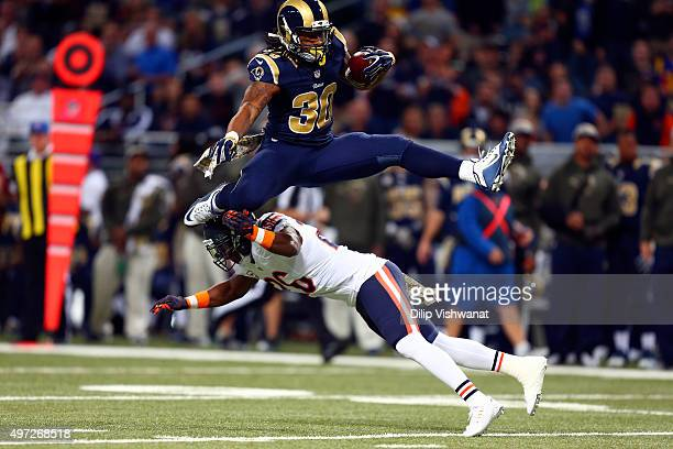 Todd Gurley of the St Louis Rams leaps over Antrel Rolle of the Chicago Bears as he carries the ball in the first quarter at the Edward Jones Dome on...