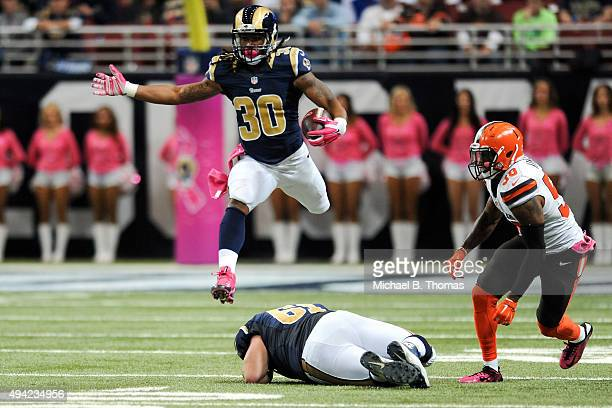 Todd Gurley of the St Louis Rams leaps over teammate Tim Barnes as he carries the ball in the third quarter against the Cleveland Browns at the...