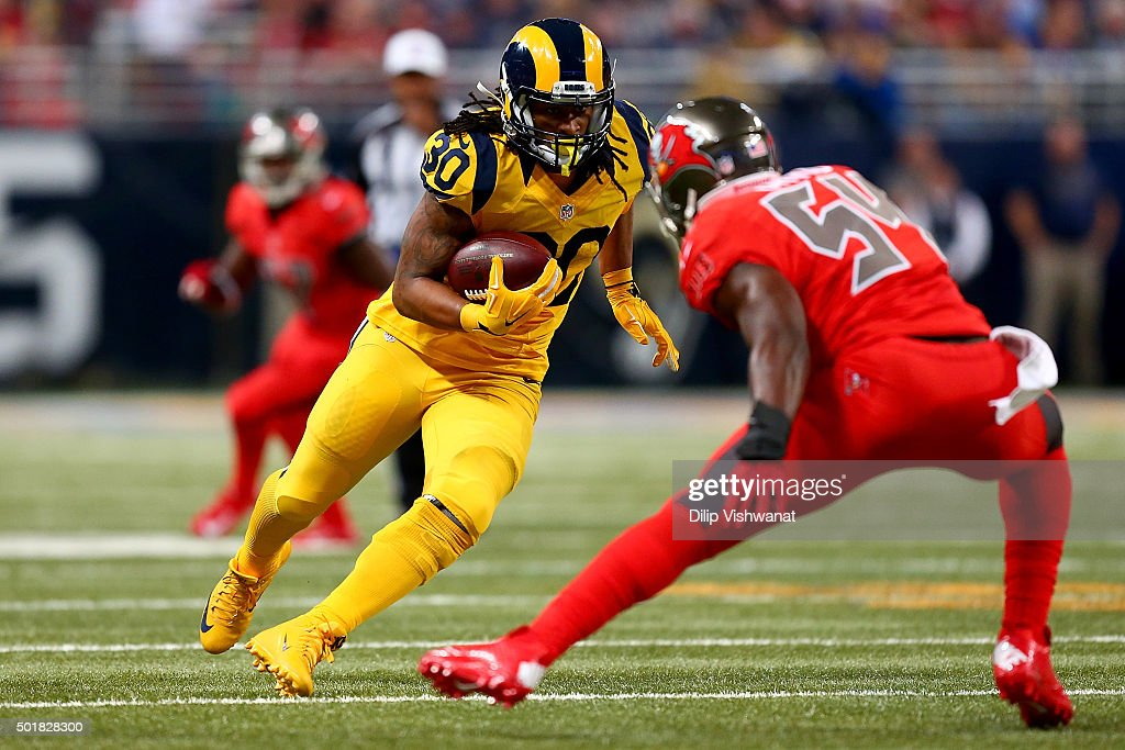 Todd Gurley #30 of the St. Louis Rams rushes against Lavonte David #54 of the Tampa Bay Buccaneers in the second quarter at the Edward Jones Dome on December 17, 2015 in St. Louis, Missouri.