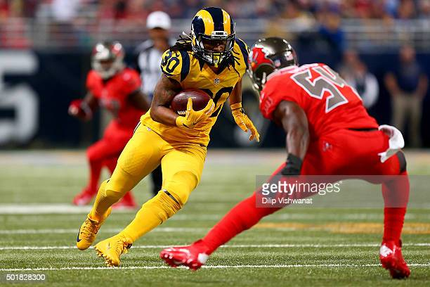 Todd Gurley of the St Louis Rams rushes against Lavonte David of the Tampa Bay Buccaneers in the second quarter at the Edward Jones Dome on December...