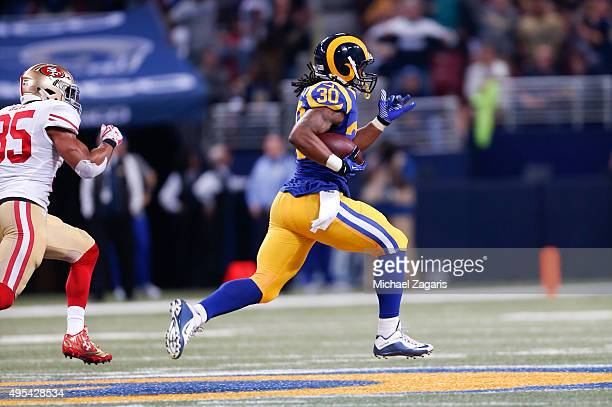Todd Gurley of the St Louis Rams rushes for a 71yard touchdown during the game against the San Francisco 49ers at the Edward Jones Dome on November 1...