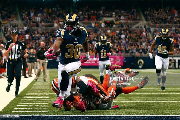 Todd Gurley of the St Louis Rams scores a touchdown in the fourth quarter against the Cleveland Browns at the Edward Jones Dome on October 25 2015 in...