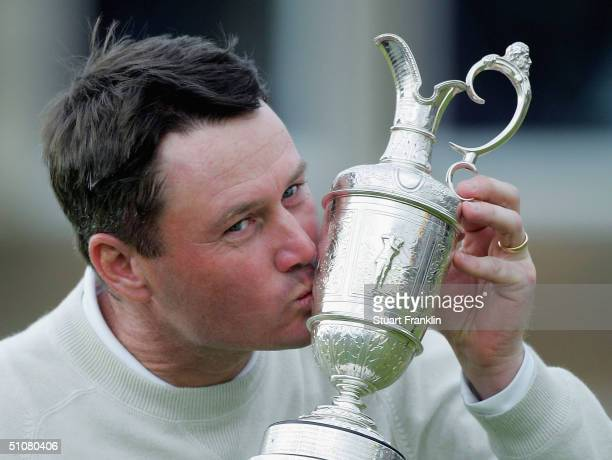 Todd Hamilton of the USA kisses the claret jug following his victory in the 133rd Open Championship after a playoff at the Royal Troon Golf Club on...