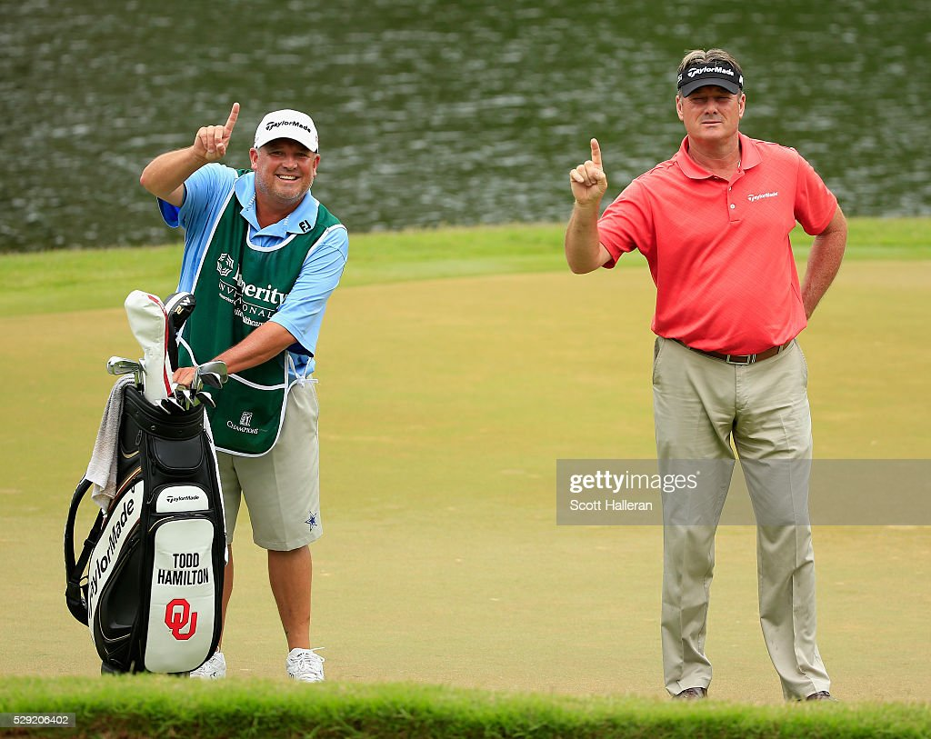 Todd Hamilton poses on the third green with his caddie David Rawls after a holeinone during the final round of the Insperity Invitational at The...