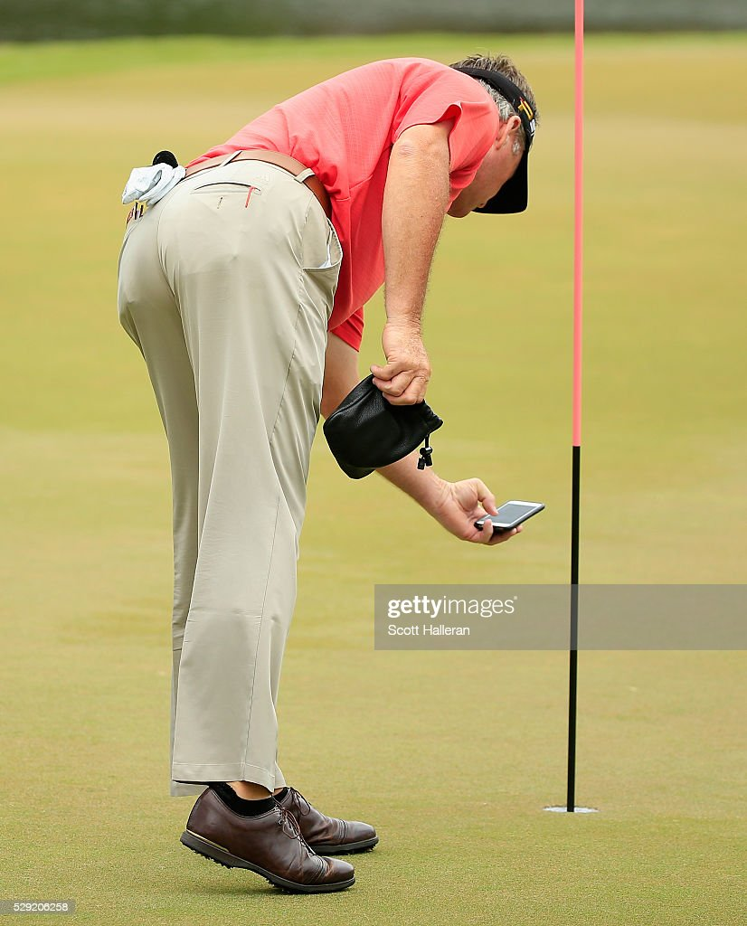 Todd Hamilton takes a cell phone photo on the third hole after a holeinone during the final round of the Insperity Invitational at The Woodlands...