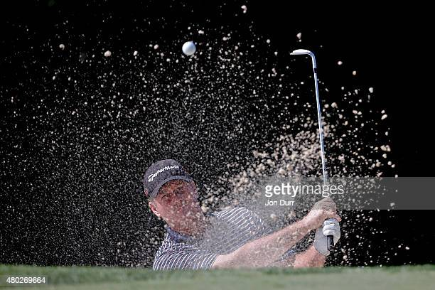 Todd Hamilton takes a shot in a bunker on the fifth hole during the second round of the John Deere Classic held at TPC Deere Run on July 10 2015 in...