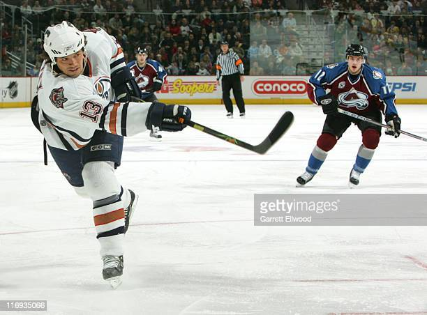 Todd Harvey of the Edmonton Oilers shoots during the game against the Colorado Avalanche on February 7 2006 at Pepsi Center in Denver Colorado