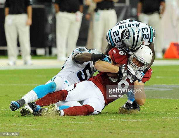 Todd Heap of the Arizona Cardinals gets tackled by Sherrod Martin of the Carolina Panthers in the NFL season opening game at the University of...