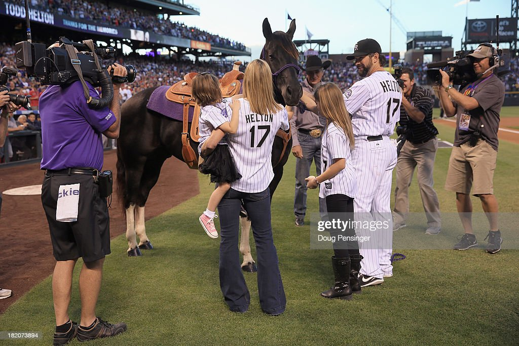 <a gi-track='captionPersonalityLinkClicked' href=/galleries/search?phrase=Todd+Helton&family=editorial&specificpeople=200735 ng-click='$event.stopPropagation()'>Todd Helton</a> (R) #17 of the Colorado Rockies is joined by his wife Christy (2R) and daughters Tierney Faith (2L) and Gentry Grace (L) as he is given a Tobiano Gelding Paint Horse named 'A Tru Bustamove' as a retirement present from the organzation during pregame ceremonies as he prepares to play his final home game at Coors Field on September 25, 2013 in Denver, Colorado.