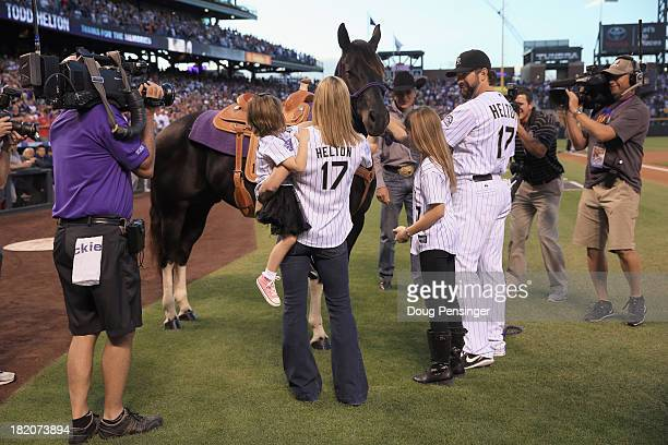 Todd Helton of the Colorado Rockies is joined by his wife Christy and daughters Tierney Faith and Gentry Grace as he is given a Tobiano Gelding Paint...