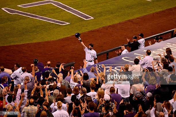Todd Helton hits a homerun off of Boston Red Sox starting pitcher Jake Peavy the start of action in Denver The Colorado Rockies hosted the Boston Red...