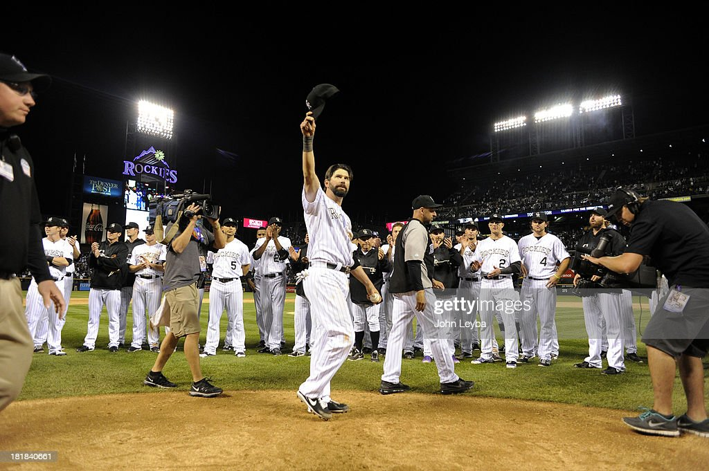 Todd Helton (17) of the Colorado Rockies acknowledges the crowd with a wave of his hat after taking a lap around the field at the end of the game against the Boston Red Sox September 25, 2013 at Coors Field. Helton will retire at the end of the season after 17 years with the club.