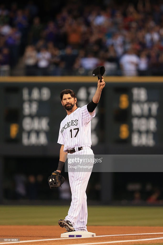 <a gi-track='captionPersonalityLinkClicked' href=/galleries/search?phrase=Todd+Helton&family=editorial&specificpeople=200735 ng-click='$event.stopPropagation()'>Todd Helton</a> #17 of the Colorado Rockies acknowledges the crowds standing ovation as he takes the field to face the Boston Red Sox for his final home game at Coors Field on September 25, 2013 in Denver, Colorado.