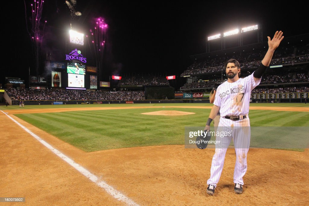 <a gi-track='captionPersonalityLinkClicked' href=/galleries/search?phrase=Todd+Helton&family=editorial&specificpeople=200735 ng-click='$event.stopPropagation()'>Todd Helton</a> #17 of the Colorado Rockies acknowledges the standing ovation from the fans after he played his last home game at Coors Field on September 25, 2013 in Denver, Colorado. The Boston Red Sox defeated the Rockies 15-5.