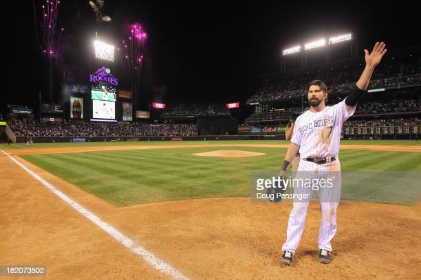 Todd Helton of the Colorado Rockies acknowledges the standing ovation from the fans after he played his last home game at Coors Field on September 25...