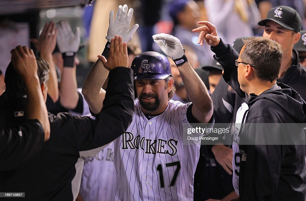 <a gi-track='captionPersonalityLinkClicked' href=/galleries/search?phrase=Todd+Helton&family=editorial&specificpeople=200735 ng-click='$event.stopPropagation()'>Todd Helton</a> #17 of the Colorado Rockies celebrates his pinch hit two run homerun to tie the score 5-5 with the Los Angeles Dodgers in the bottom of the ninth inning at Coors Field on May 31, 2013 in Denver, Colorado.
