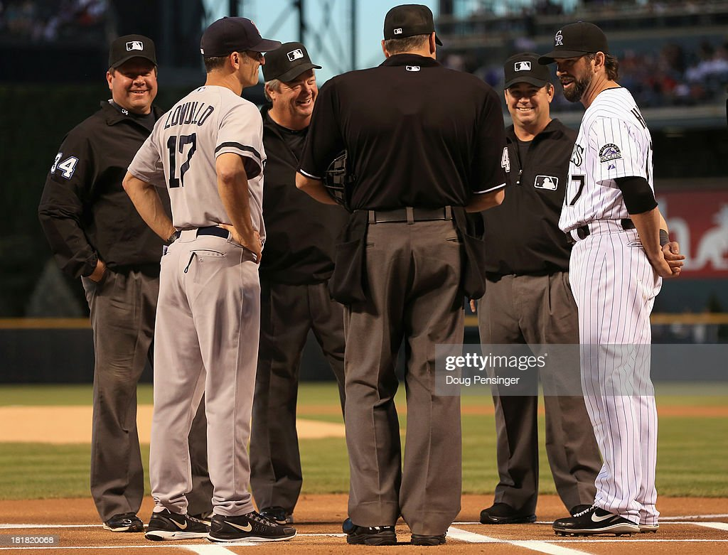 Todd Helton #17 of the Colorado Rockies delivers the lineup to the umpires along with Torey Lovullo #17 of the Boston Red Sox as Helton prepares to play his final home game at Coors Field on September 25, 2013 in Denver, Colorado.