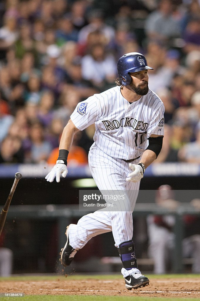 <a gi-track='captionPersonalityLinkClicked' href=/galleries/search?phrase=Todd+Helton&family=editorial&specificpeople=200735 ng-click='$event.stopPropagation()'>Todd Helton</a> #17 of the Colorado Rockies doubles in the sixth inning of a game against the Arizona Diamondbacks at Coors Field on September 20, 2013 in Denver, Colorado.