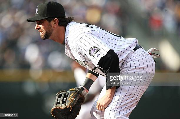 Todd Helton of the Colorado Rockies fields against the Philadelphia Phillies in Game Four of the NLDS during the 2009 MLB Playoffs at Coors Field on...