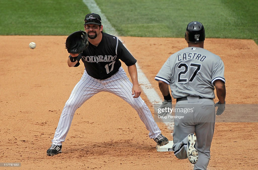<a gi-track='captionPersonalityLinkClicked' href=/galleries/search?phrase=Todd+Helton&family=editorial&specificpeople=200735 ng-click='$event.stopPropagation()'>Todd Helton</a> #17 of the Colorado Rockies gets a put out on <a gi-track='captionPersonalityLinkClicked' href=/galleries/search?phrase=Ramon+Castro&family=editorial&specificpeople=208997 ng-click='$event.stopPropagation()'>Ramon Castro</a> #27 of the Chicago White Sox during Interleague play at Coors Field on June 30, 2011 in Denver, Colorado. Helton played in his 2000th career Major League Baseball game, all of them with the Colorado Rockies.