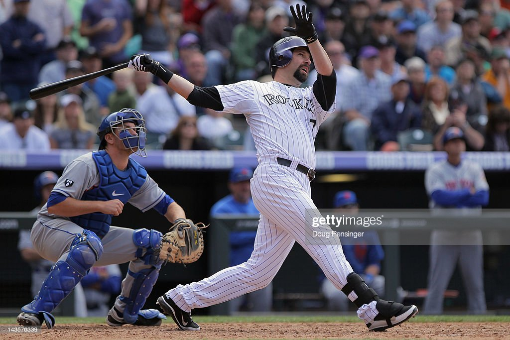 <a gi-track='captionPersonalityLinkClicked' href=/galleries/search?phrase=Todd+Helton&family=editorial&specificpeople=200735 ng-click='$event.stopPropagation()'>Todd Helton</a> #17 of the Colorado Rockies hits a pinch hit grand slam homer run off of relief pitcher Tim Byrdak #40 of the New York Mets to tie the score 4-4 with two out in the eighth inning at Coors Field on April 29, 2012 in Denver, Colorado.