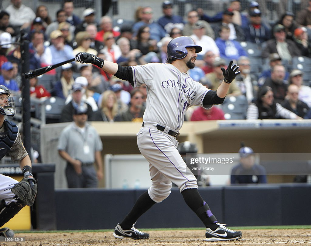 <a gi-track='captionPersonalityLinkClicked' href=/galleries/search?phrase=Todd+Helton&family=editorial&specificpeople=200735 ng-click='$event.stopPropagation()'>Todd Helton</a> #17 of the Colorado Rockies hits a two-run homer during the seventh inning of a baseball game against the San Diego Padres at Petco Park on April 14, 2013 in San Diego, California. The Rockies won 2-1.