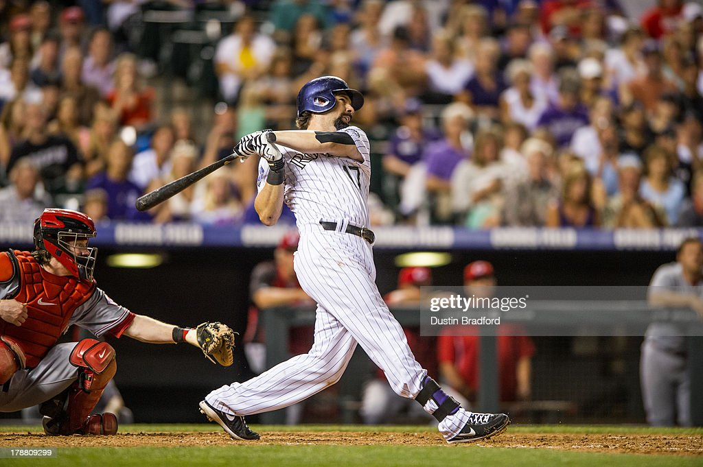 <a gi-track='captionPersonalityLinkClicked' href=/galleries/search?phrase=Todd+Helton&family=editorial&specificpeople=200735 ng-click='$event.stopPropagation()'>Todd Helton</a> #17 of the Colorado Rockies hits his second three-run home run of the game for his 2,499th career hit in the seventh inning of a game against the Cincinnati Reds at Coors Field on August 30, 2013 in Denver, Colorado. The Rockies beat the Reds 9-6.