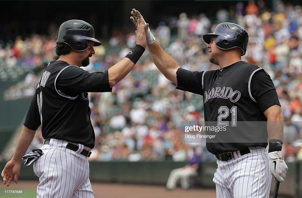 <a gi-track='captionPersonalityLinkClicked' href=/galleries/search?phrase=Todd+Helton&family=editorial&specificpeople=200735 ng-click='$event.stopPropagation()'>Todd Helton</a> #17 of the Colorado Rockies is welcomed home by <a gi-track='captionPersonalityLinkClicked' href=/galleries/search?phrase=Ty+Wigginton&family=editorial&specificpeople=211533 ng-click='$event.stopPropagation()'>Ty Wigginton</a> #21 of the Rockies after Helton scored on a home run by Troy Tulowitzki of the Rockies in the first inning against the Chicago White Sox during Interleague play at Coors Field on June 30, 2011 in Denver, Colorado. Helton played in his 2000th career Major League Baseball game, all of them with the Colorado Rockies.