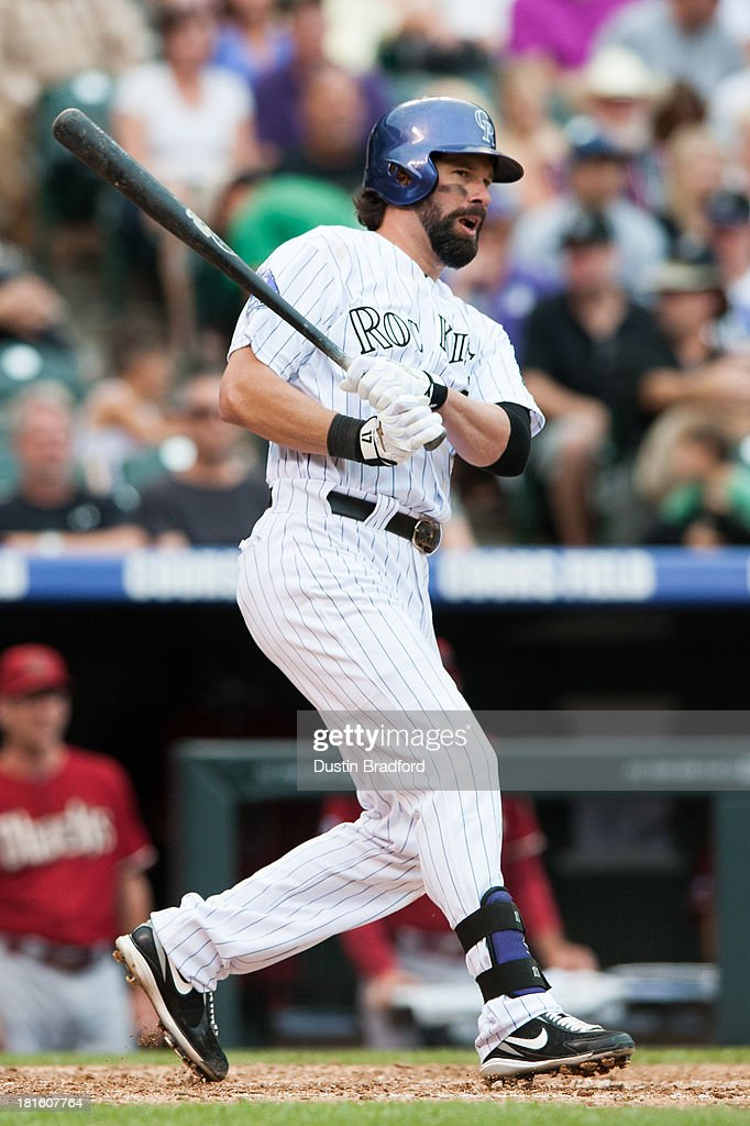 <a gi-track='captionPersonalityLinkClicked' href=/galleries/search?phrase=Todd+Helton&family=editorial&specificpeople=200735 ng-click='$event.stopPropagation()'>Todd Helton</a> #17 of the Colorado Rockies knocks in two runs with a fifth inning double against the Arizona Diamondbacks at Coors Field on September 22, 2013 in Denver, Colorado. The double resulted in Helton's 1400th RBI.