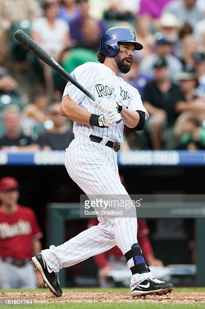 Todd Helton of the Colorado Rockies knocks in two runs with a fifth inning double against the Arizona Diamondbacks at Coors Field on September 22...