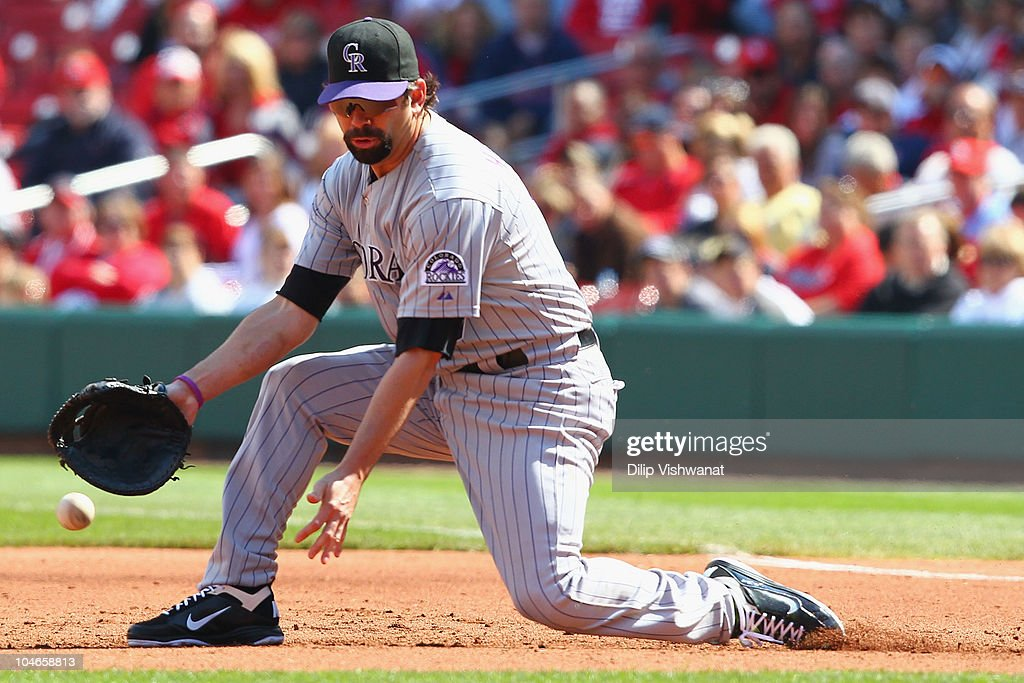 <a gi-track='captionPersonalityLinkClicked' href=/galleries/search?phrase=Todd+Helton&family=editorial&specificpeople=200735 ng-click='$event.stopPropagation()'>Todd Helton</a> #17 of the Colorado Rockies mis plays a ground ball against the St. Louis Cardinals at Busch Stadium on October 2, 2010 in St. Louis, Missouri. The Cardinals beat the Rockies 1-0 in 11 innings.
