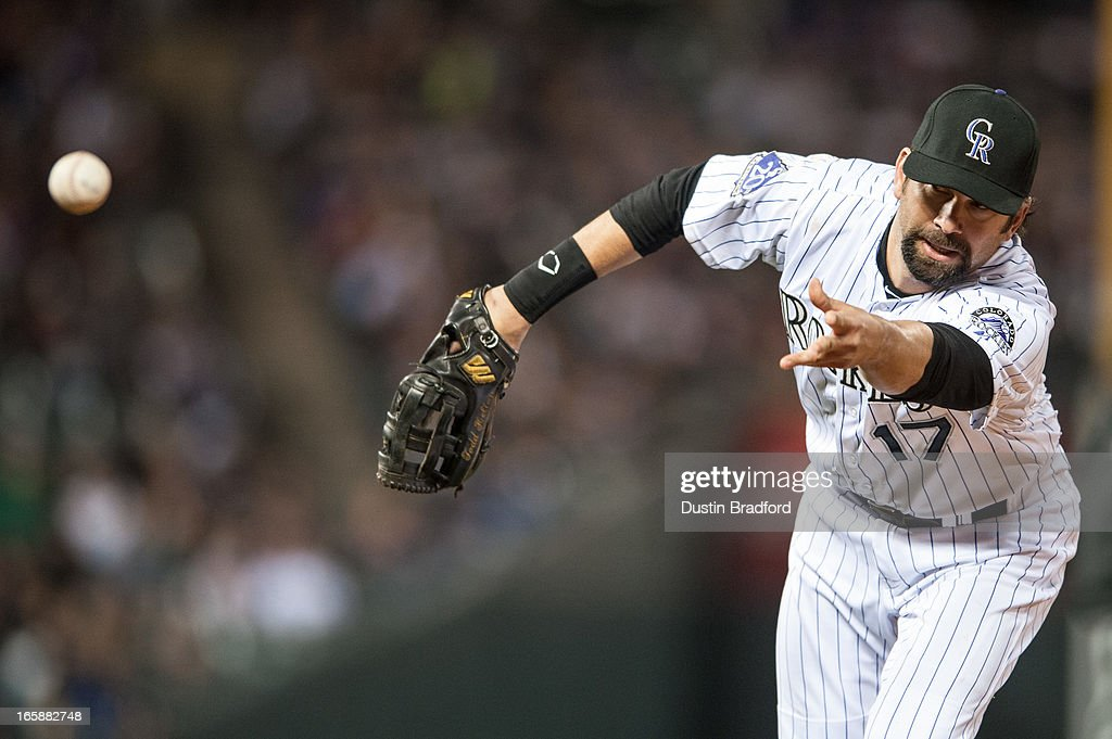 <a gi-track='captionPersonalityLinkClicked' href=/galleries/search?phrase=Todd+Helton&family=editorial&specificpeople=200735 ng-click='$event.stopPropagation()'>Todd Helton</a> #17 of the Colorado Rockies puts out a runner at first base in the seventh inning of a game against the San Diego Padres at Coors Field on April 6, 2013 in Denver, Colorado. The Rockies Beat the Padres 6-3.