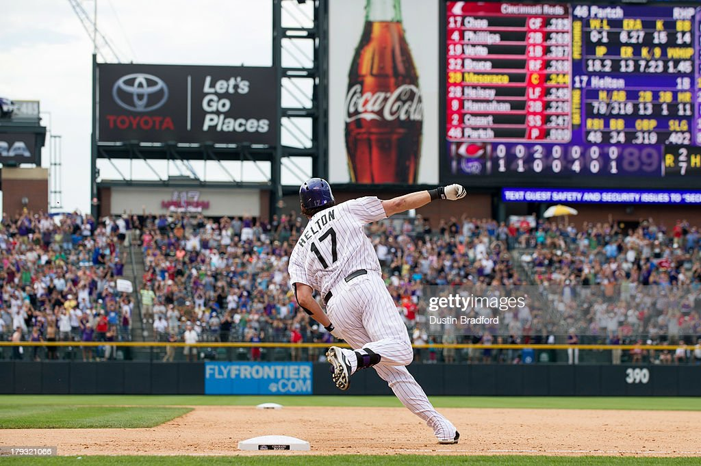 <a gi-track='captionPersonalityLinkClicked' href=/galleries/search?phrase=Todd+Helton&family=editorial&specificpeople=200735 ng-click='$event.stopPropagation()'>Todd Helton</a> #17 of the Colorado Rockies rounds first base on his way to second base for a double and what would be his 2,500th career hit in the seventh inning of a game against the Cincinnati Reds at Coors Field on September 1, 2013 in Denver, Colorado.