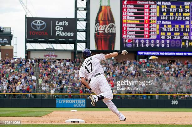 Todd Helton of the Colorado Rockies rounds first base on his way to second base for a double and what would be his 2500th career hit in the seventh...
