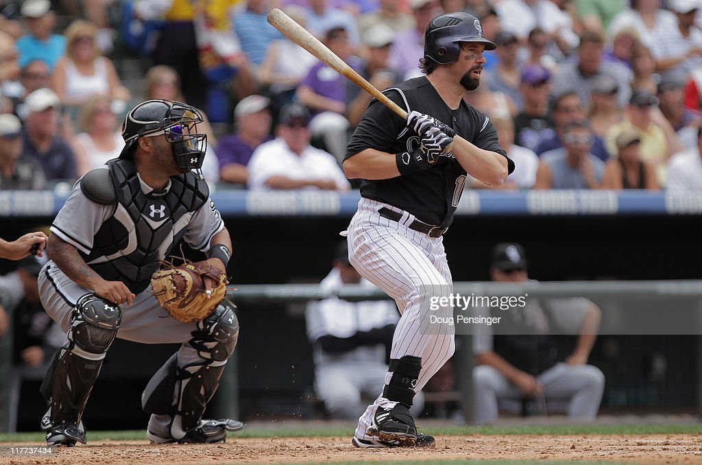 <a gi-track='captionPersonalityLinkClicked' href=/galleries/search?phrase=Todd+Helton&family=editorial&specificpeople=200735 ng-click='$event.stopPropagation()'>Todd Helton</a> #17 of the Colorado Rockies singles in the third inning as catcher <a gi-track='captionPersonalityLinkClicked' href=/galleries/search?phrase=Ramon+Castro&family=editorial&specificpeople=208997 ng-click='$event.stopPropagation()'>Ramon Castro</a> #27 of the Chicago White Sox backs up the plate during Interleague play at Coors Field on June 30, 2011 in Denver, Colorado. Helton played in his 2000th career Major League Baseball game, all of them with the Colorado Rockies.