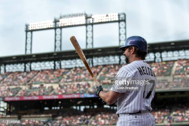 Todd Helton of the Colorado Rockies stands in the ondeck circle before an atbat against the Los Angeles Dodgers at Coors Field on July 4 2013 in...