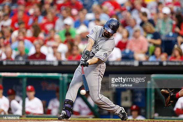 Todd Helton of the Colorado Rockies swings at a pitch during the game against the Philadelphia Phillies at Citizens Bank Park on August 22 2013 in...