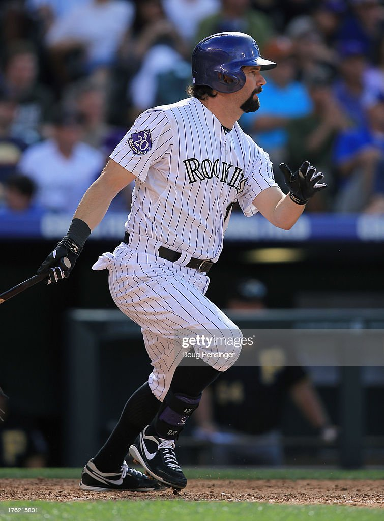 <a gi-track='captionPersonalityLinkClicked' href=/galleries/search?phrase=Todd+Helton&family=editorial&specificpeople=200735 ng-click='$event.stopPropagation()'>Todd Helton</a> #17 of the Colorado Rockies takes an at bat against the Pittsburgh Pirates at Coors Field on August 11, 2013 in Denver, Colorado. The Rockies defeated the Pirates 3-2 and swept the three game series.