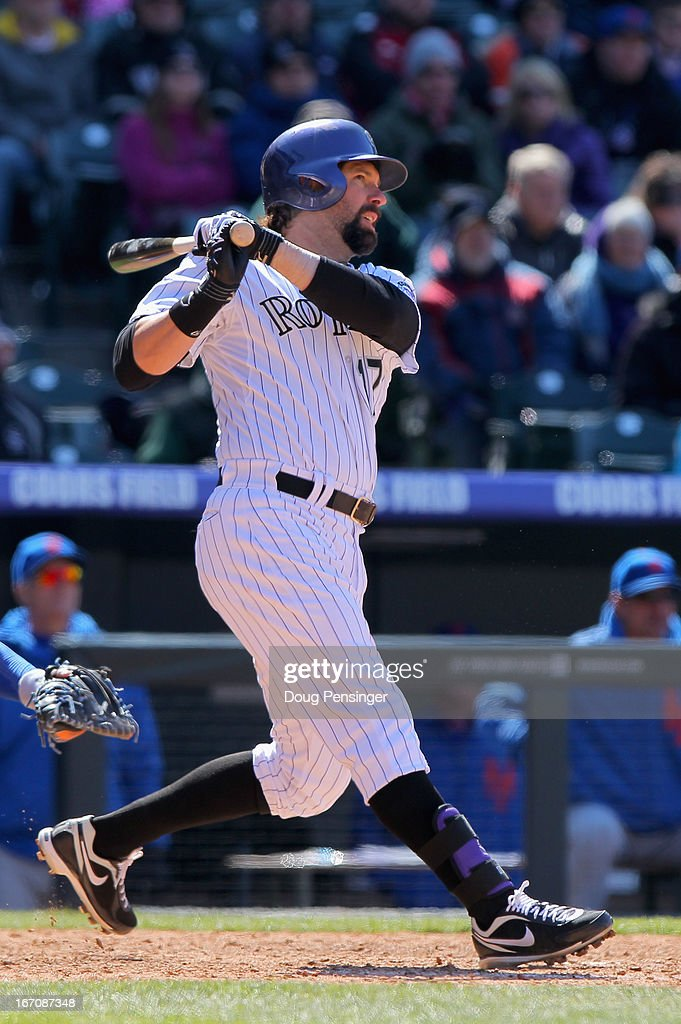 <a gi-track='captionPersonalityLinkClicked' href=/galleries/search?phrase=Todd+Helton&family=editorial&specificpeople=200735 ng-click='$event.stopPropagation()'>Todd Helton</a> #17 of the Colorado Rockies takes an at bat against the New York Mets at Coors Field on April 18, 2013 in Denver, Colorado. The Rockies defeated the Mets 11-3.