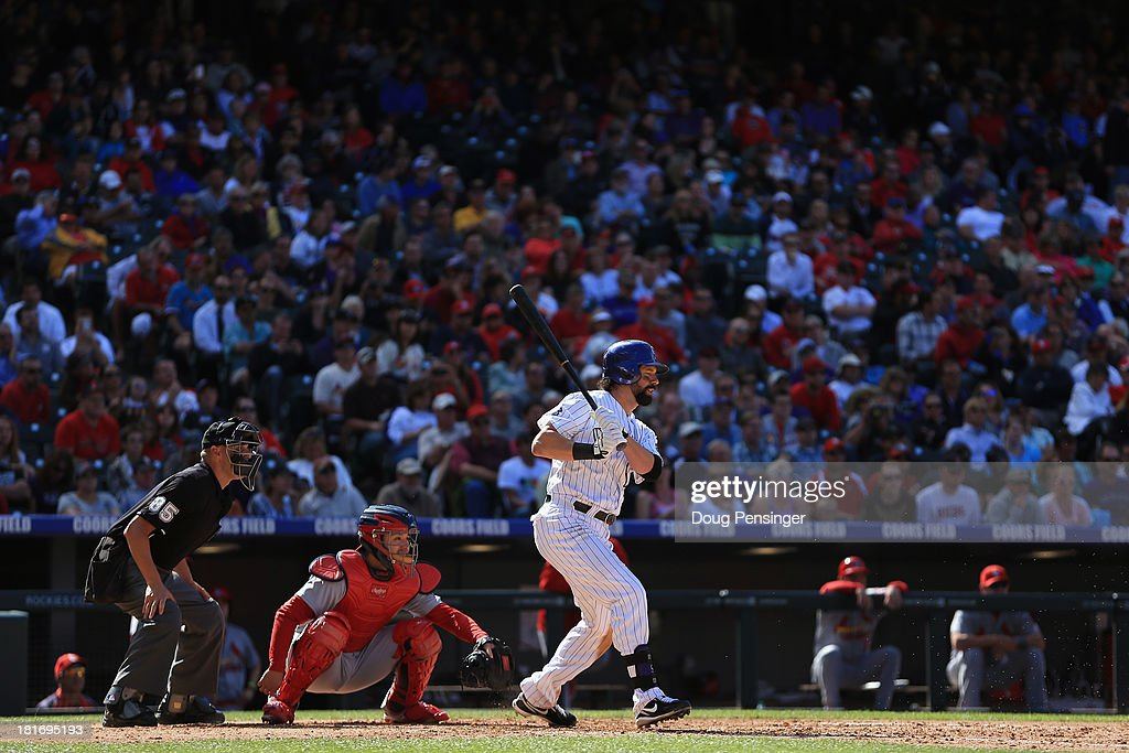 <a gi-track='captionPersonalityLinkClicked' href=/galleries/search?phrase=Todd+Helton&family=editorial&specificpeople=200735 ng-click='$event.stopPropagation()'>Todd Helton</a> #17 of the Colorado Rockies takes an at bat as catcher Tony Cruz #48 of the St. Louis Cardinals backs up the plate and homeplate umpire Vic Carapazza oversees the action at Coors Field on September 19, 2013 in Denver, Colorado.